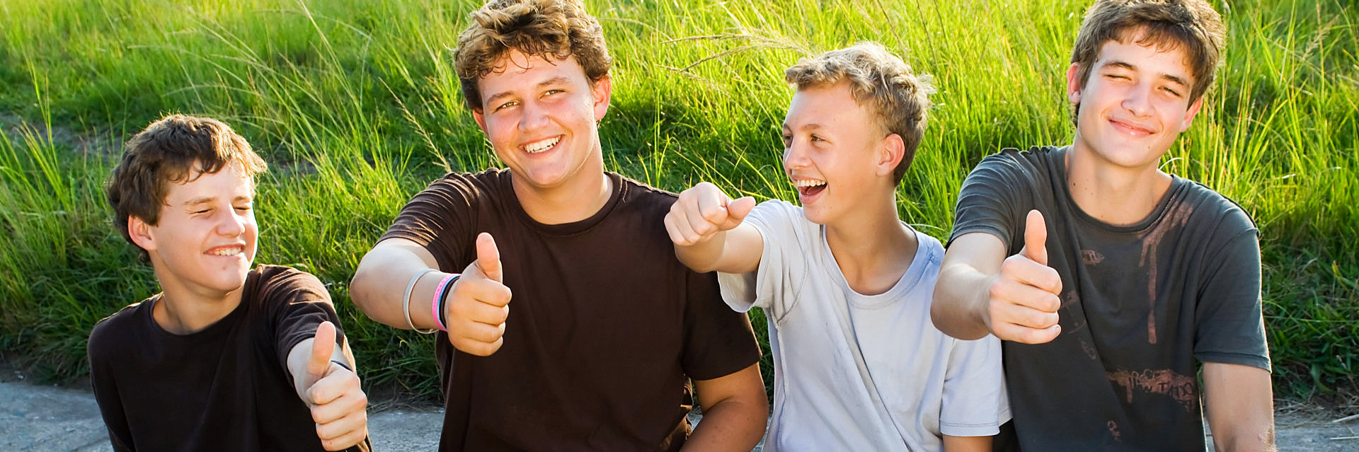 teenagers showing their thumbs up